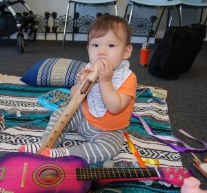 baby with flute